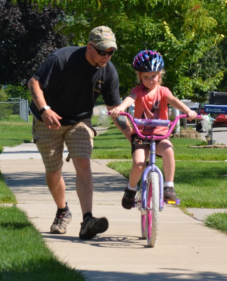 "Corey spots Sumer as she ""solos"" without training wheels"