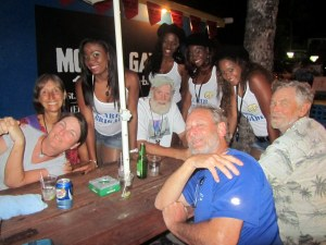 The Carib girls stop by to suggest a brand of beer...